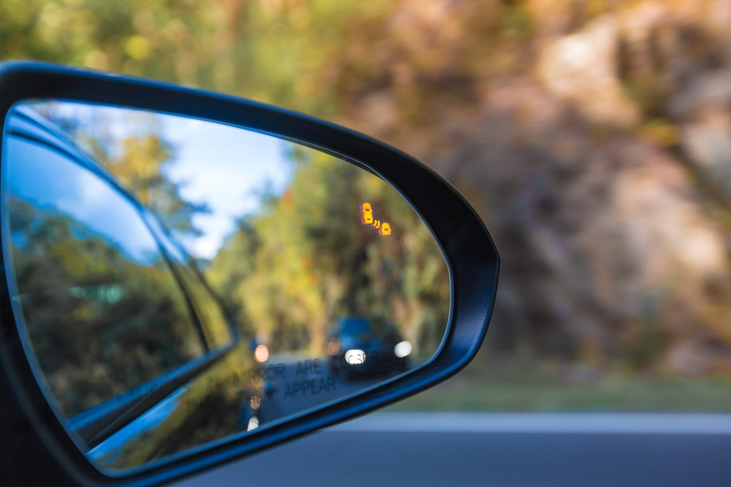 Blindspot warning signal in rearview mirror.